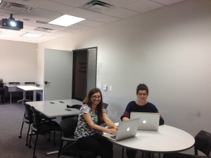 """Kristina and Corey taking notes in the """"mock"""" classroom during rehearsal."""