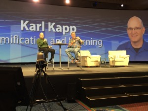 Karl Kapp riffing on games and gamification for Learning on stage with Elliott Masie.